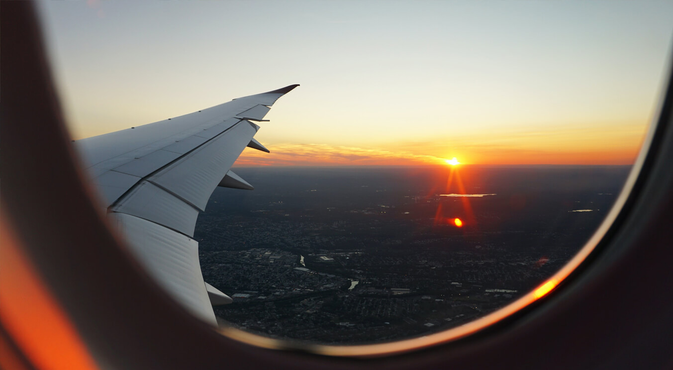 Sunrise view from an airplane window.